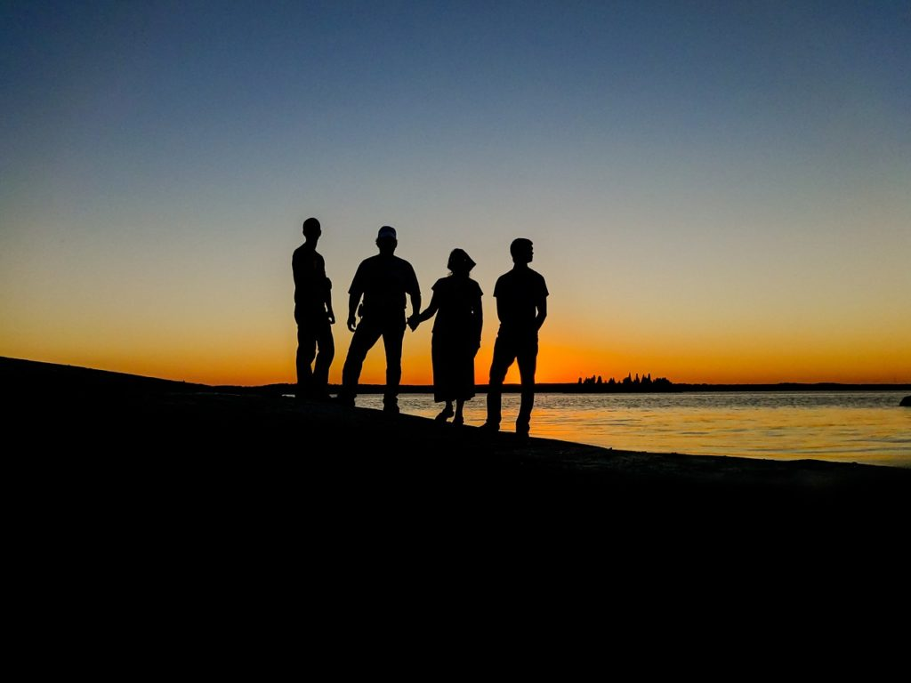 people, silhouettes, sunset